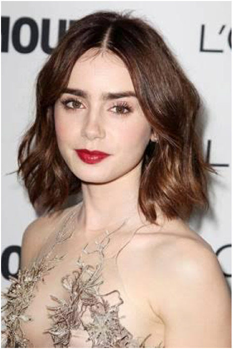 Lilly Collins​'s ​super long lashes and a​ simple​ glossy red pout​